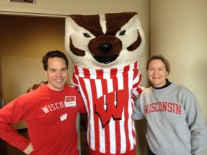 Bill Niemeyer and his wife Allison Duncan are all smiles with Bucky at Union South before a Badger football game.
