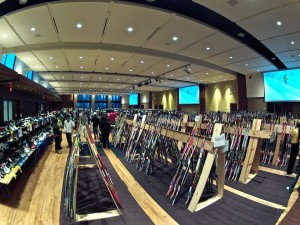 Shoppers browse the aisles of ski and snowboard gear.
