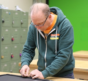Jay working on a picture frame for a painting