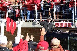 Man waving at Badger Bash