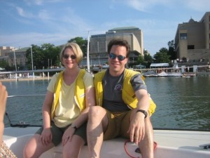 Bill and Allison get comfortable while sailing in front of the Memorial Union Terrace.