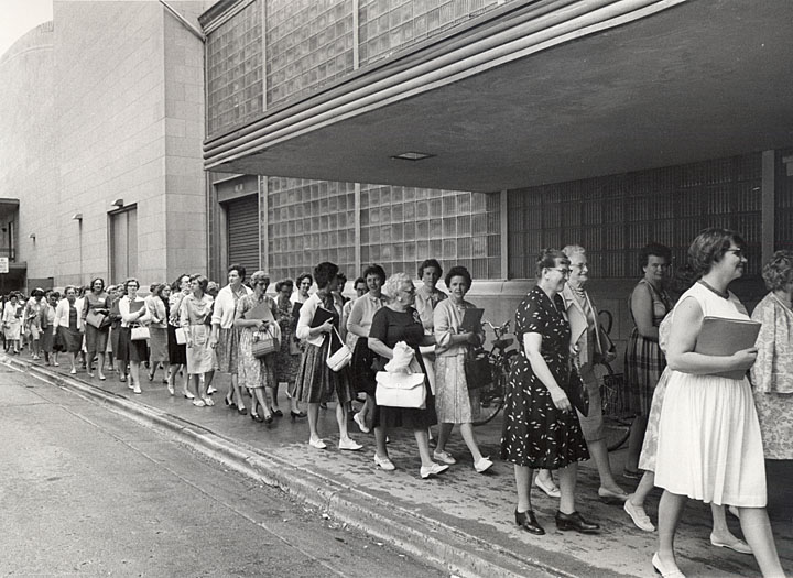 """Women line the Wisconsin Union Theater in the spring of the early 1960's for the UW Extension program """"College Week for Women."""" Typically a 3-day seminar, College Week for Women started in 1964 and featured classes and lectures on public speaking, women's rights, career advice and more. Its mission was to offer a college-like experience to women from all over Wisconsin to better themselves and the state as a whole. College Week for Women has evolved into what is now College Days and is held in early June. Photo courtesy of the Wisconsin Digital Collections and information courtesy of David Null and Jerry Apps"""
