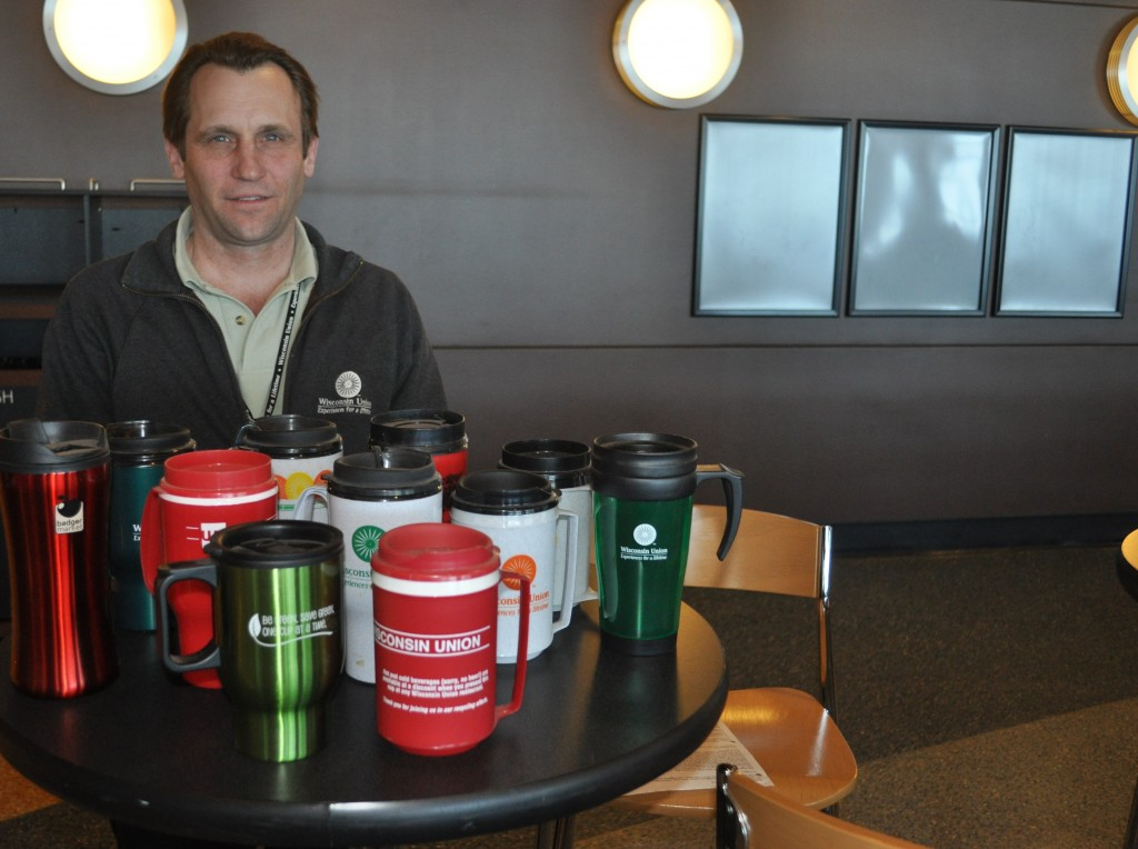 Verne Scholl with his collection of all the reusable mugs.