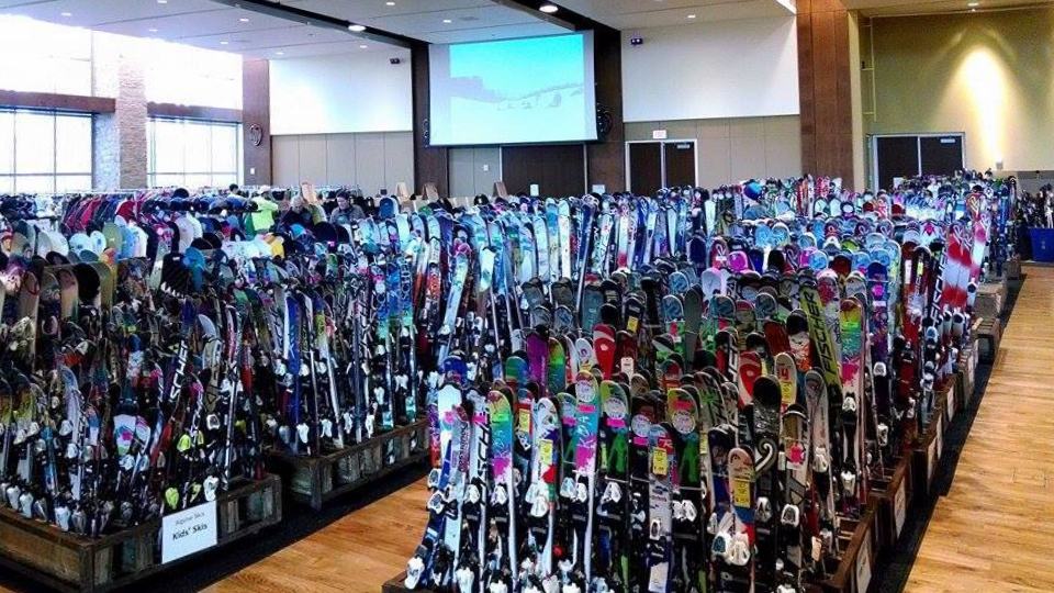 Adult and children's skis displayed at the resale.